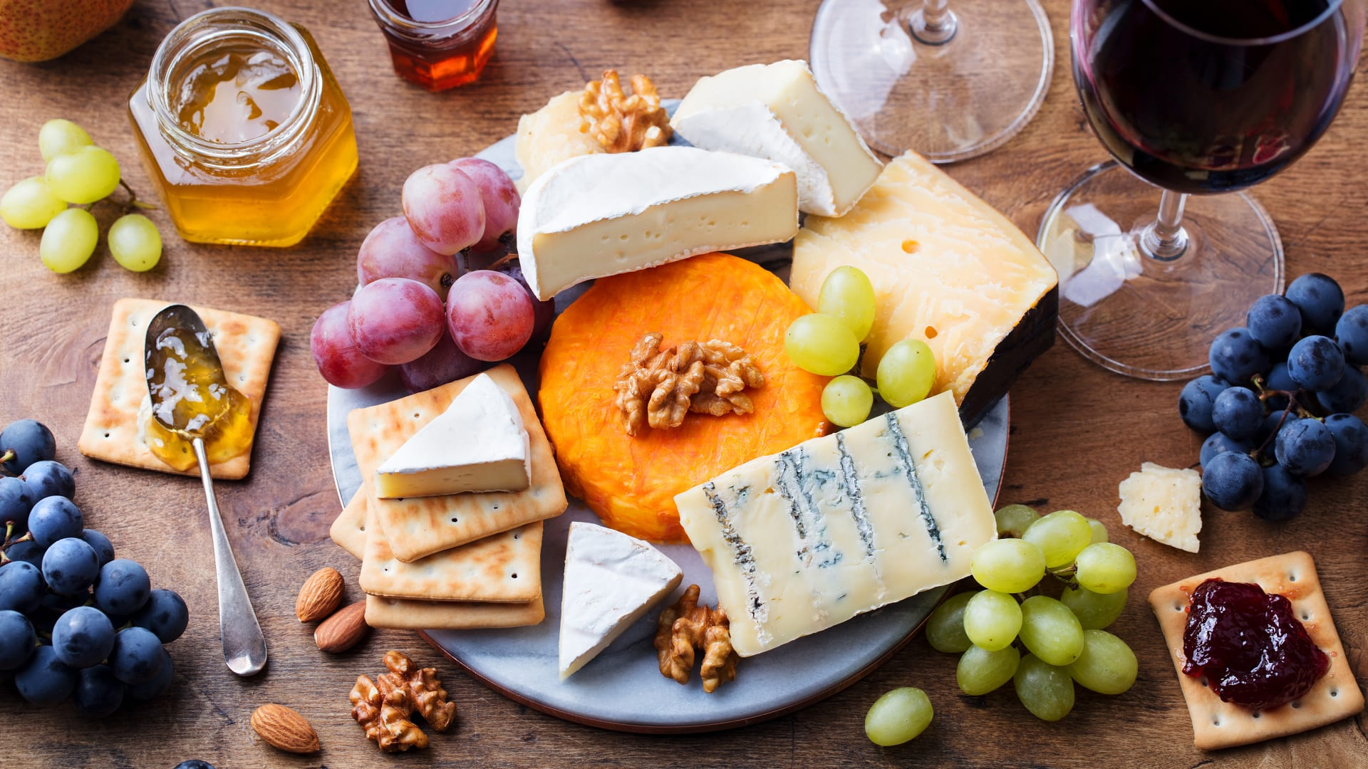 Table with cheese platter and grapes