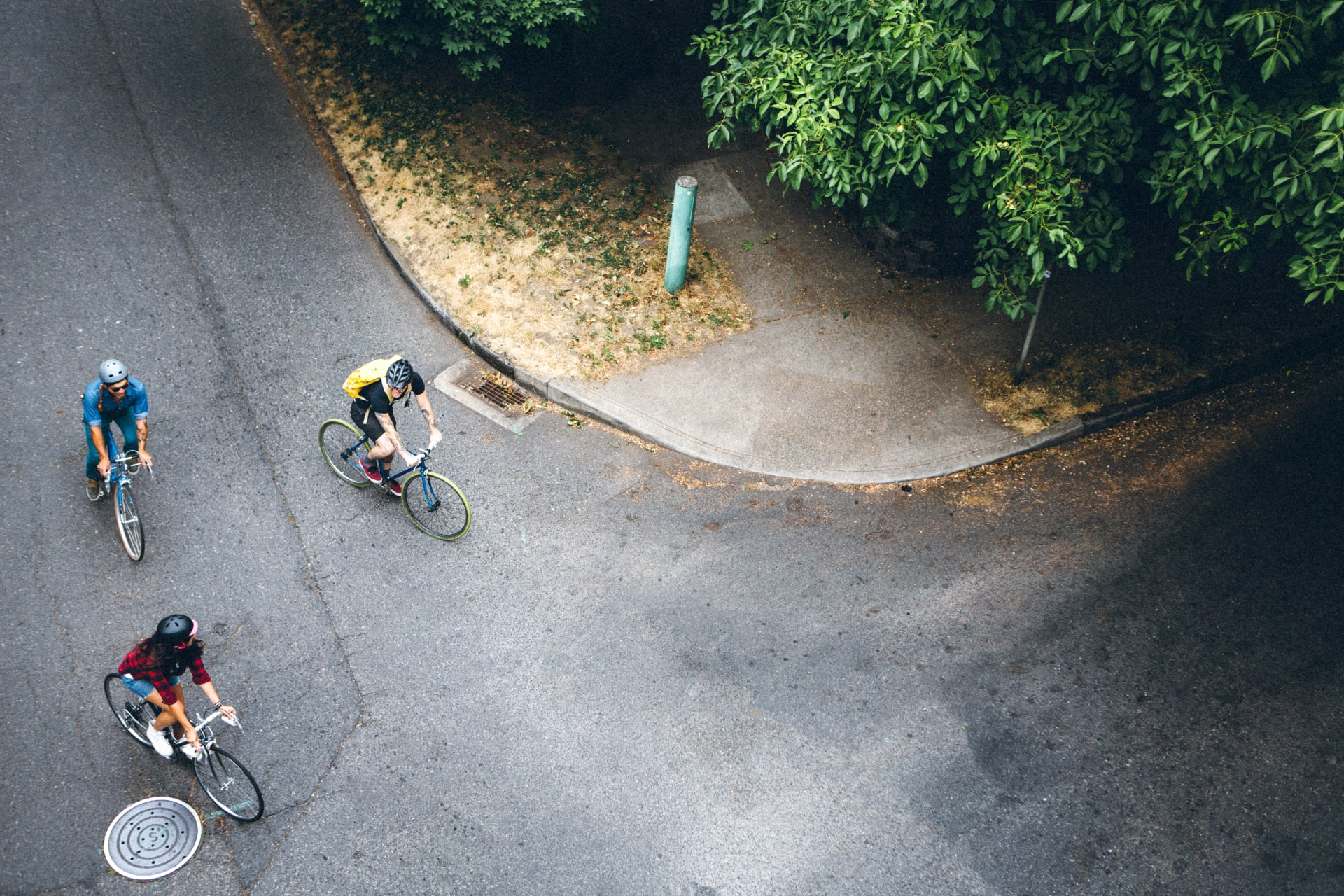 road crossing with three cyclists from above