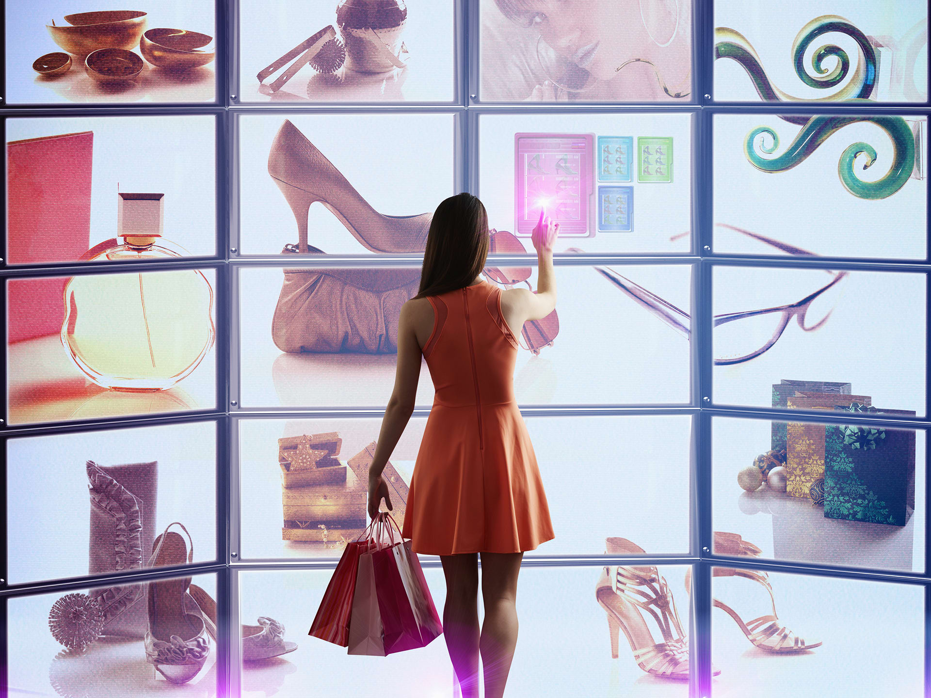 lady in red dress in front of online shopping screens