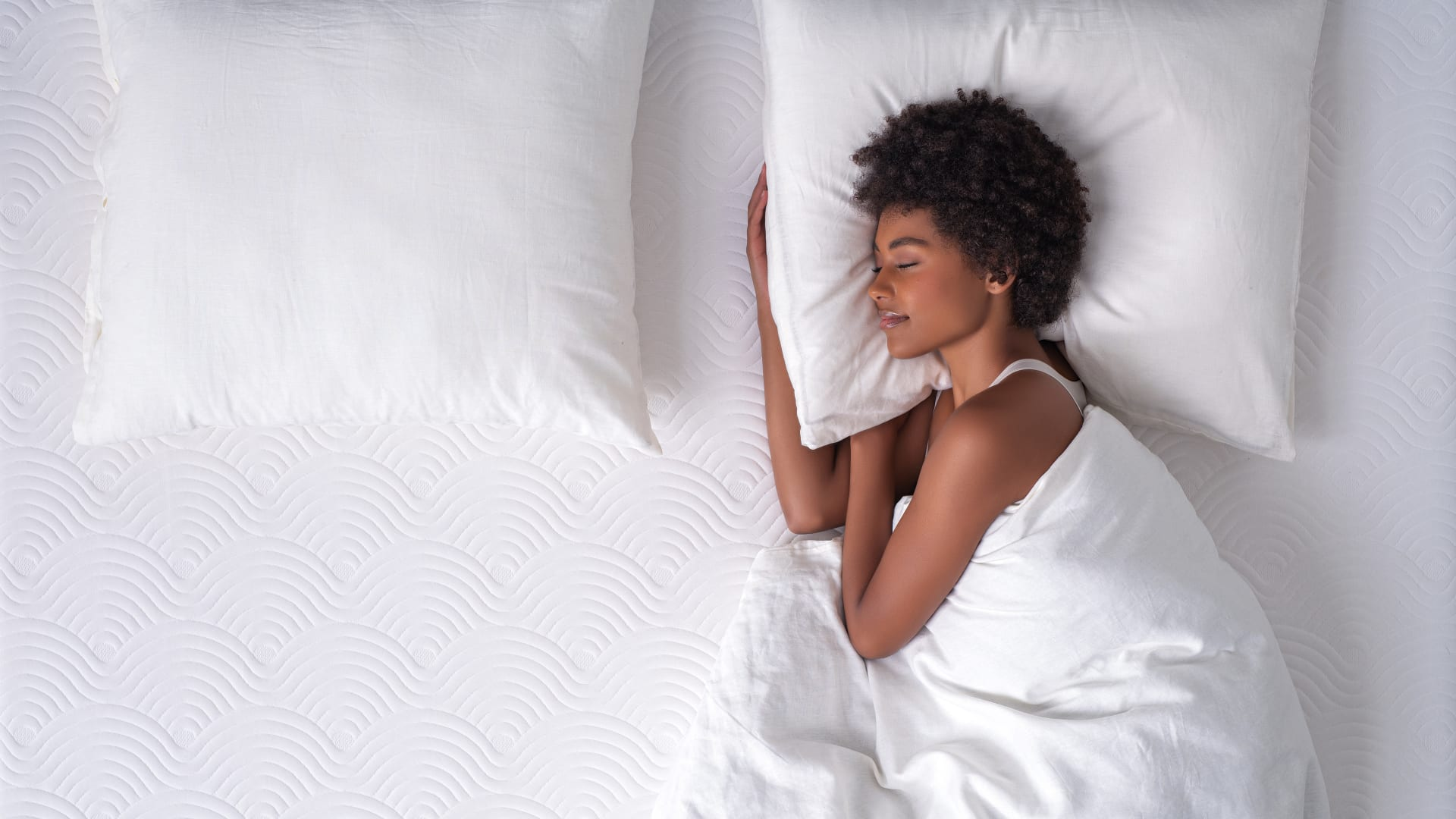 Woman sleeping on Tempur mattress