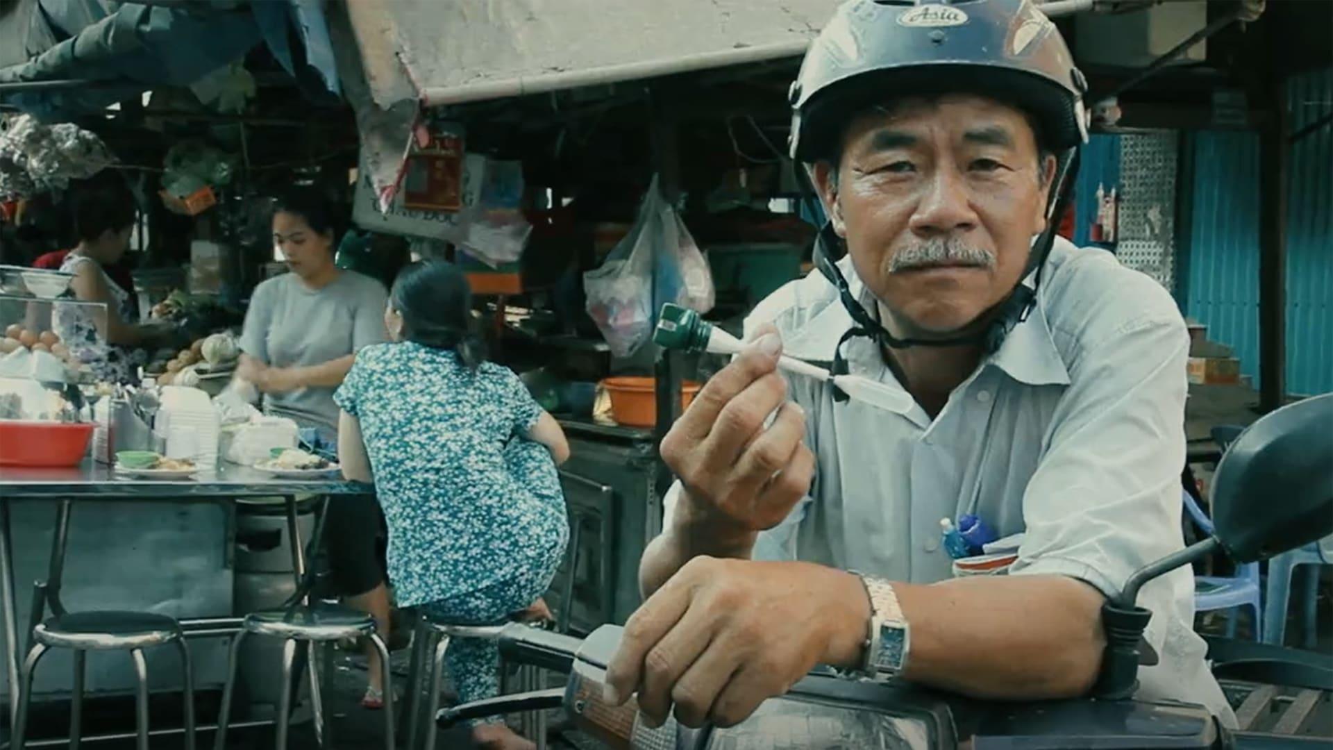 Motor Cyclist holding an oil cap