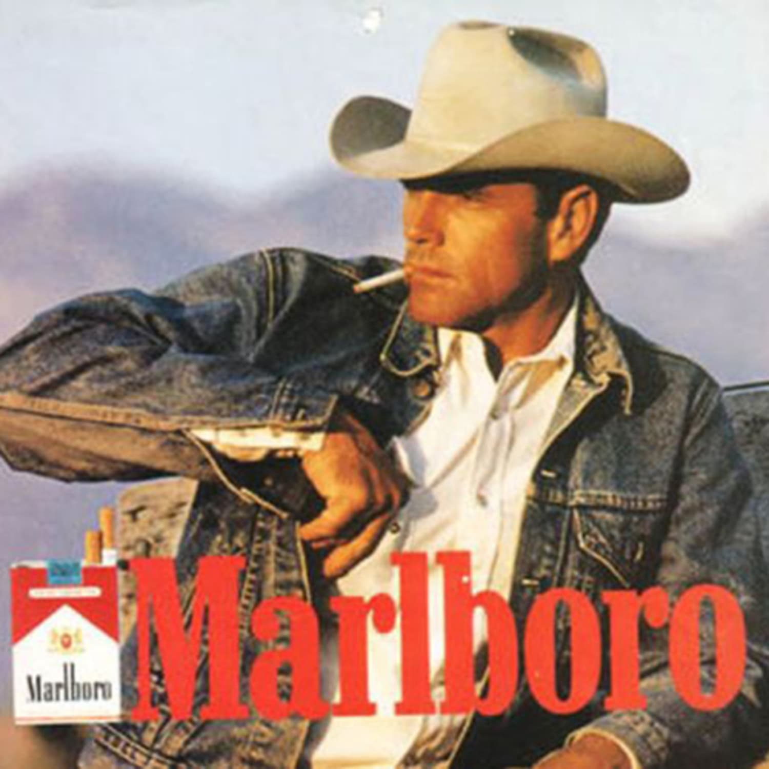 Man in cowboy hat smoking a cigarette in classic American ad for Marlboro