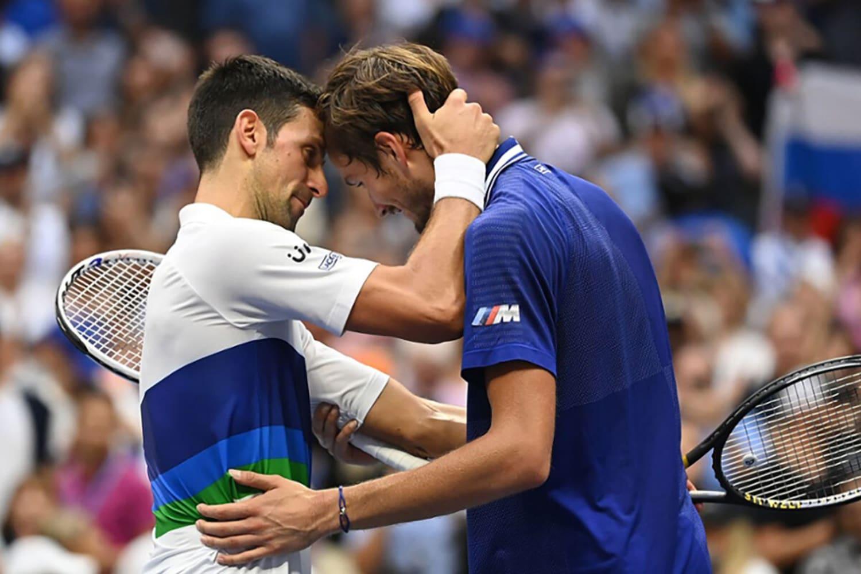 WEB Novak Djokovic hugs Daniil Medvedev after the Mens Singles championship match at the 2021 US Open Sunday Sep 12 2021 in Flushing NY Garrett Ellwood USTA