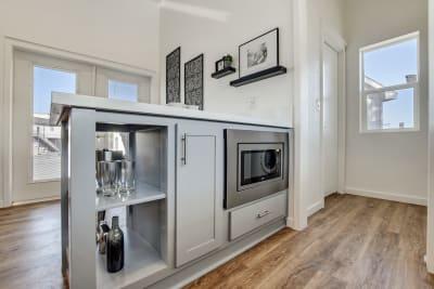Urbaneer ADU by Genesis Homes - kitchen island and microwave