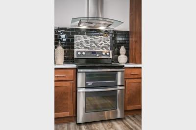 Cimarron 3264R Ultimate Kitchen Two range and mosaic tile backsplash