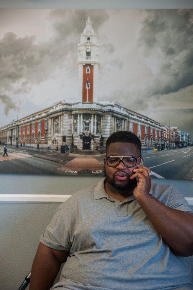 Solomon Smith and a giant photograph of Brixton Town Hall