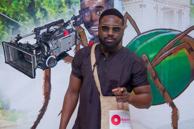 Actor Elikem Kumordzie ('Silverain' 2014) posing with the Festival bag