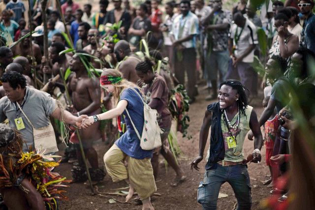 Sarah Doyle and Afro Amado dancing at an event in Vanuatu.
