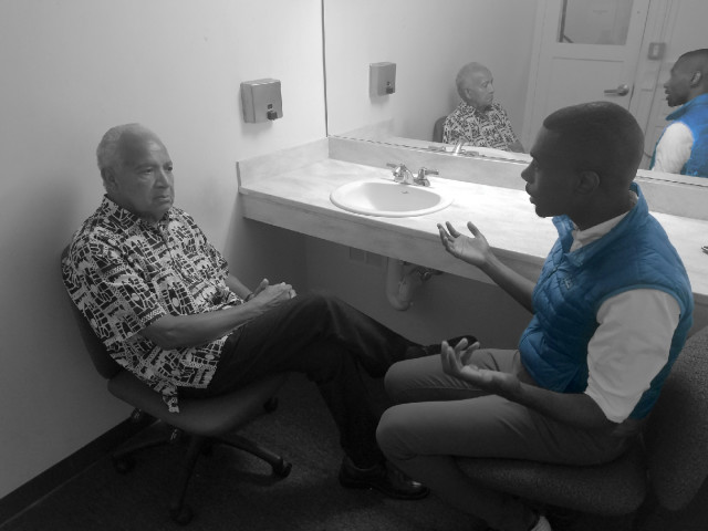 Dr. Martin Luther King's barber, Mr. Nelson Malden, talking backstage about the civil rights movement with Black Lives Matter leader, DeRay McKesson.