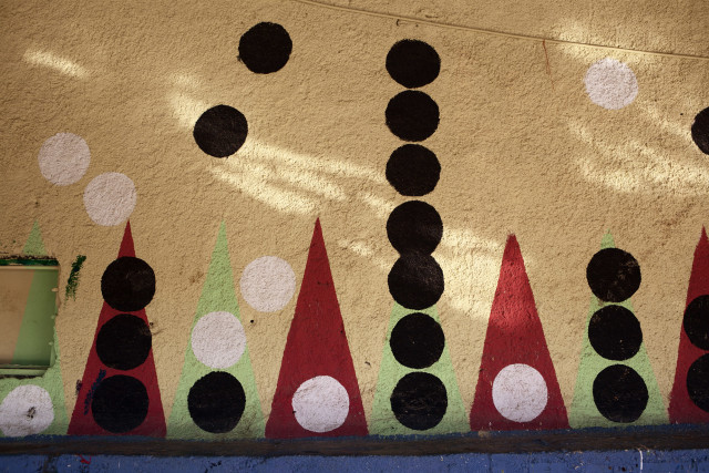 Sunlight dappling a mural created as part of The Backgammon Project