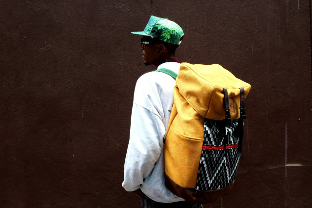 The SoulArt Foundation Masihambisane Travel Bag is handmade from recycled materials