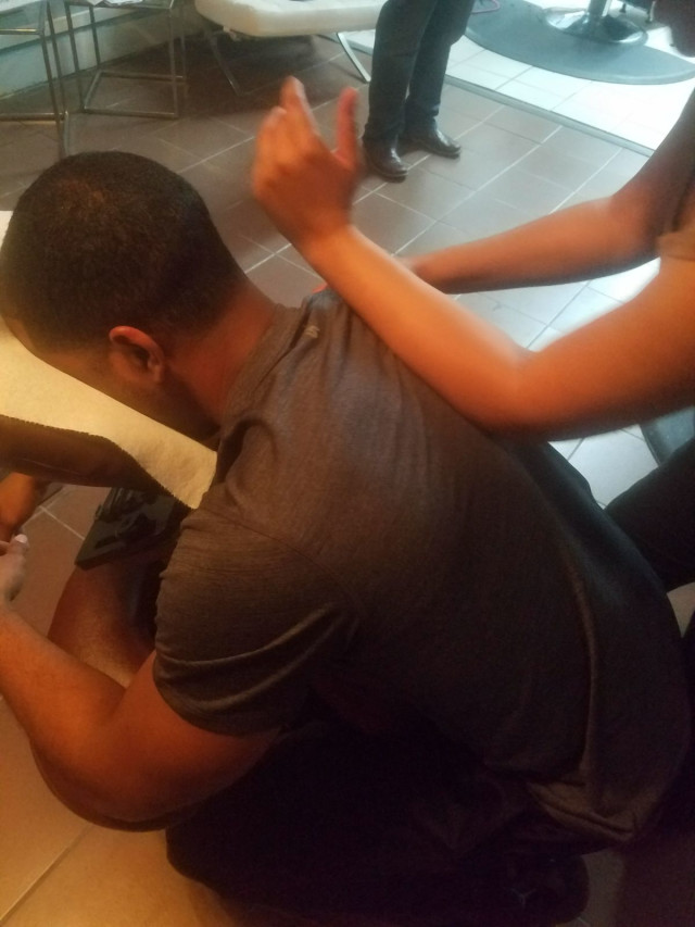 A brother about to receive his 1st free chair massage on a typical Friday night