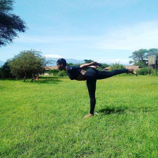 Sithule practising yoga in Kenya.