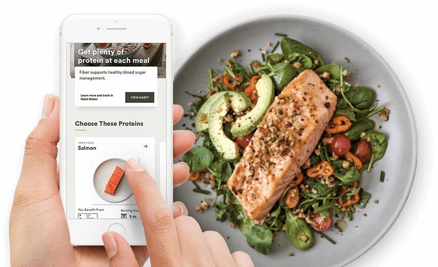 Habit Personalized Nutrition mobile App with a super healthy and tast plate of food next to it.