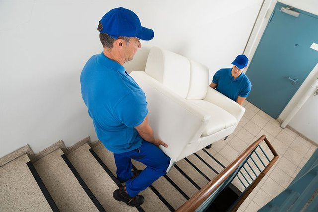 removalist carrying furniture u stairs
