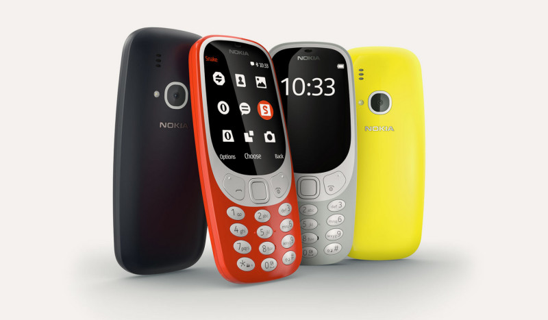 4 Nokia 3310 phones in blue, read, gray, and yellow