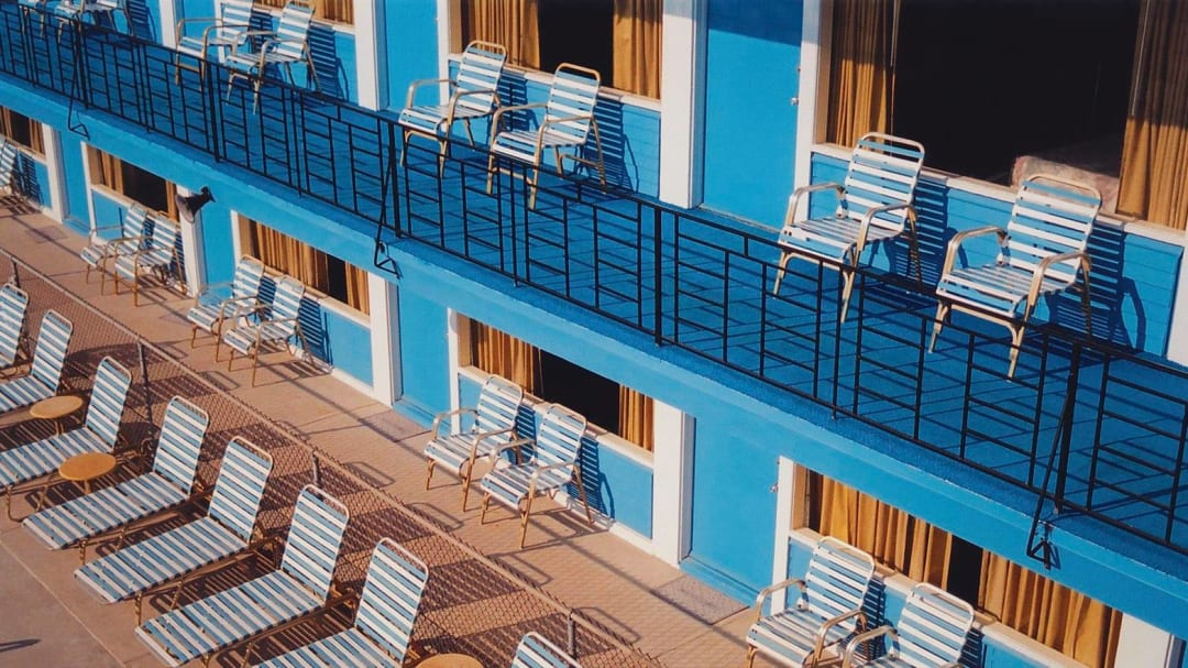 Blue chairs on blue balcony