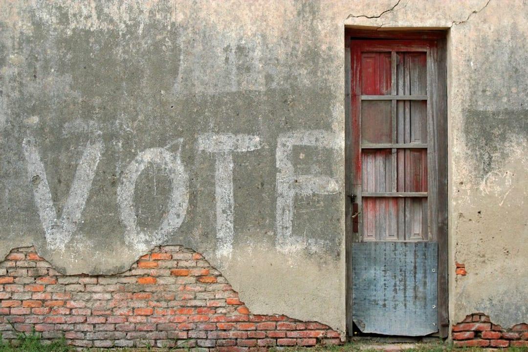 Vote written on concrete wall
