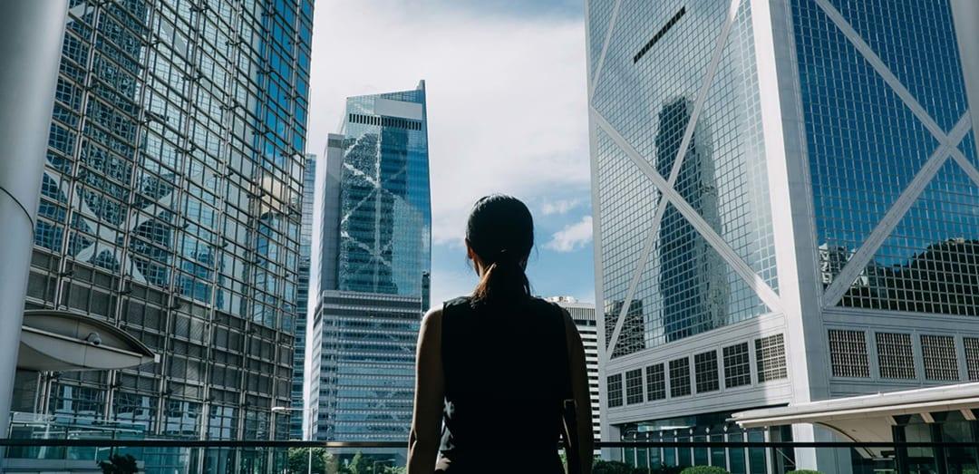 Females gazes toward buildings in city
