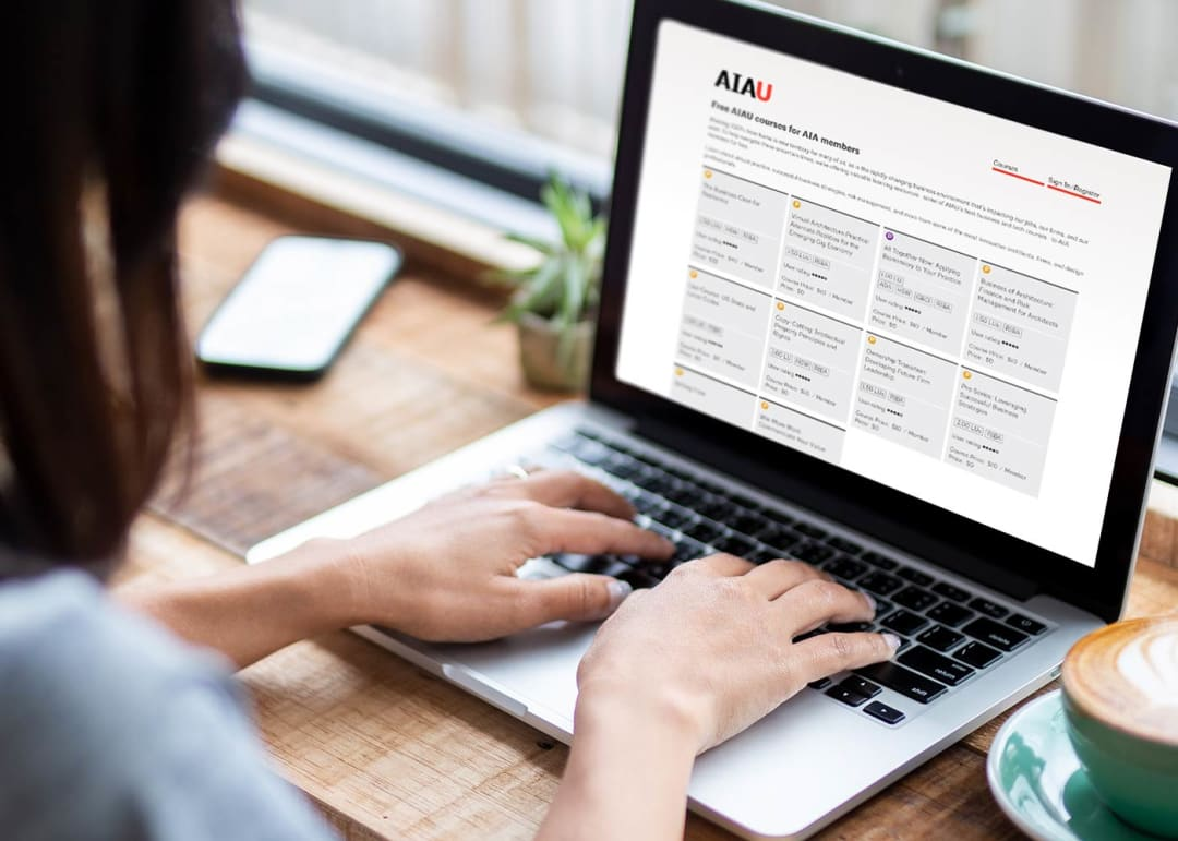 person taking an AIAU course online