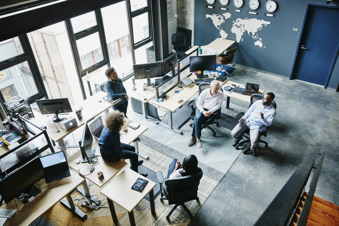 Aerial shot of a team brainstorming in an office space