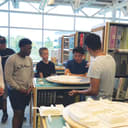 Students gathering around architectural model