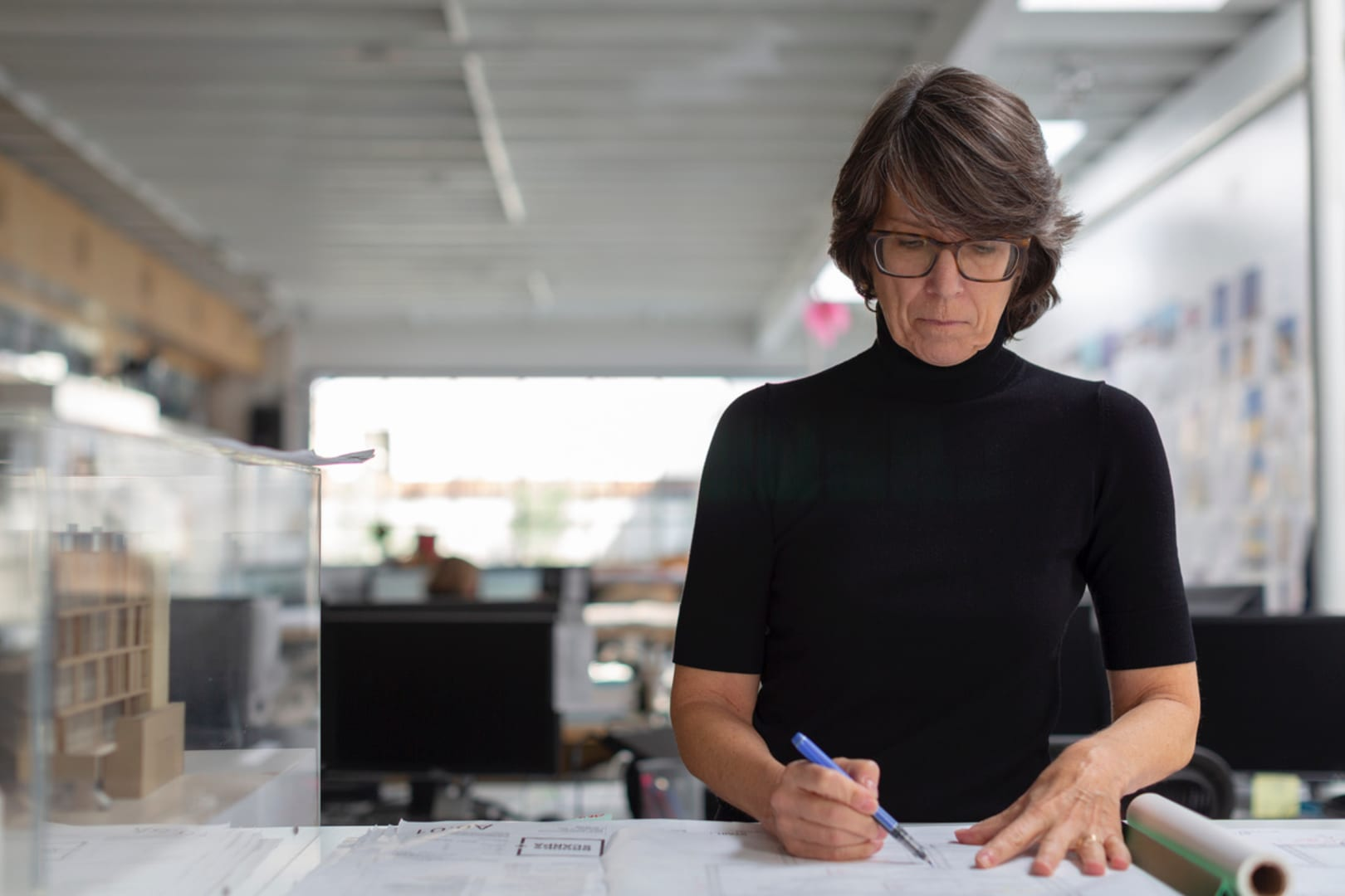 Angela Brooks, FAIA at work in her  office