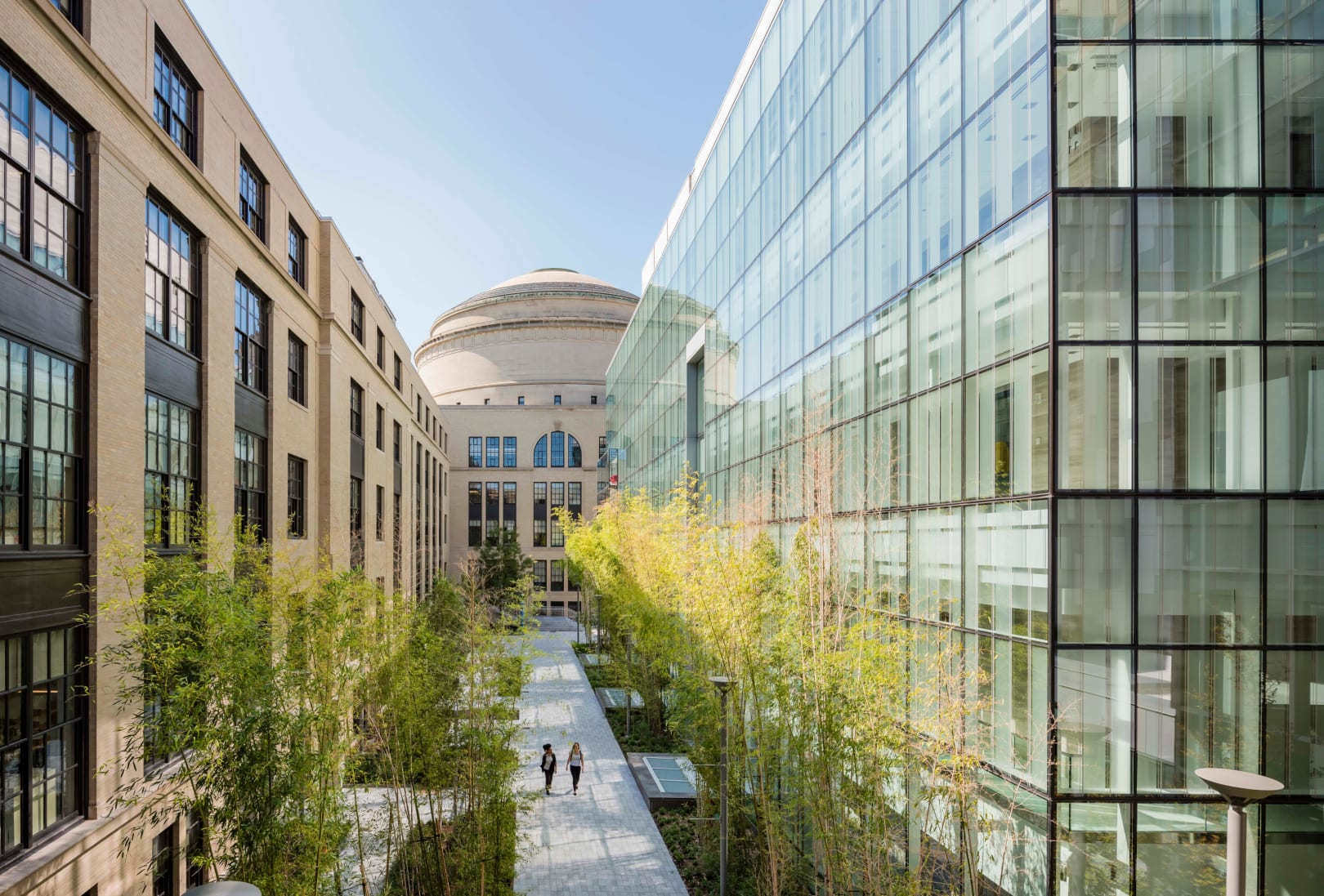 """MIT.nano forms a new campus courtyard named 'Improbability Walk' along the Main Group buildings and anchored by the Great Dome. Named in honor of one of MIT's most inspirational faculty members: the late Institute Professor Mildred """"Millie"""" Dresselhaus."""