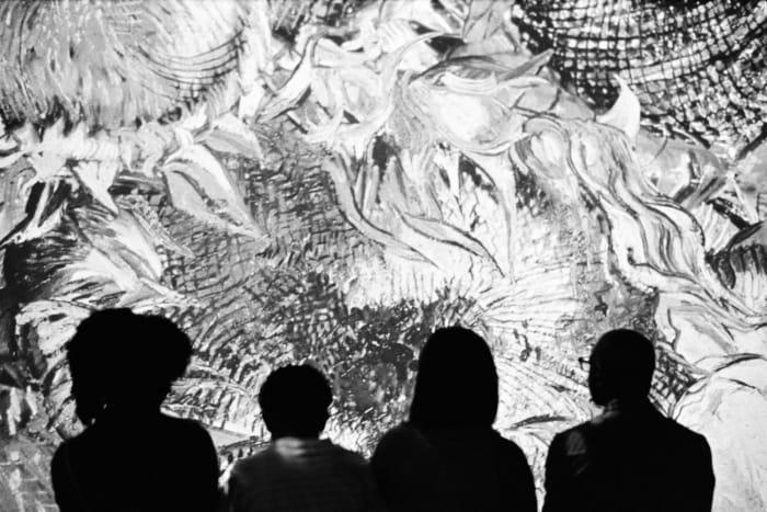 family watching van gogh immersive exhibit video