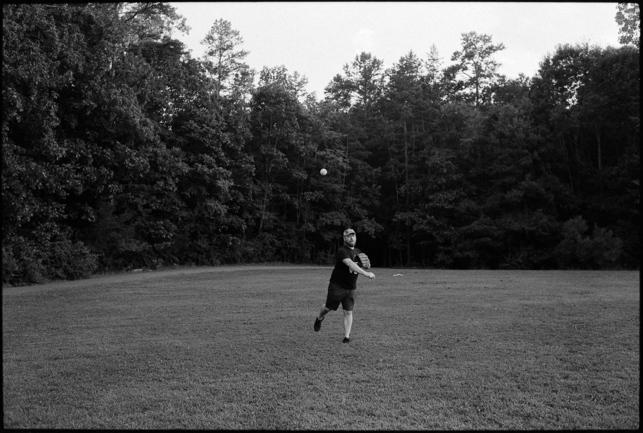 man throwing baseball