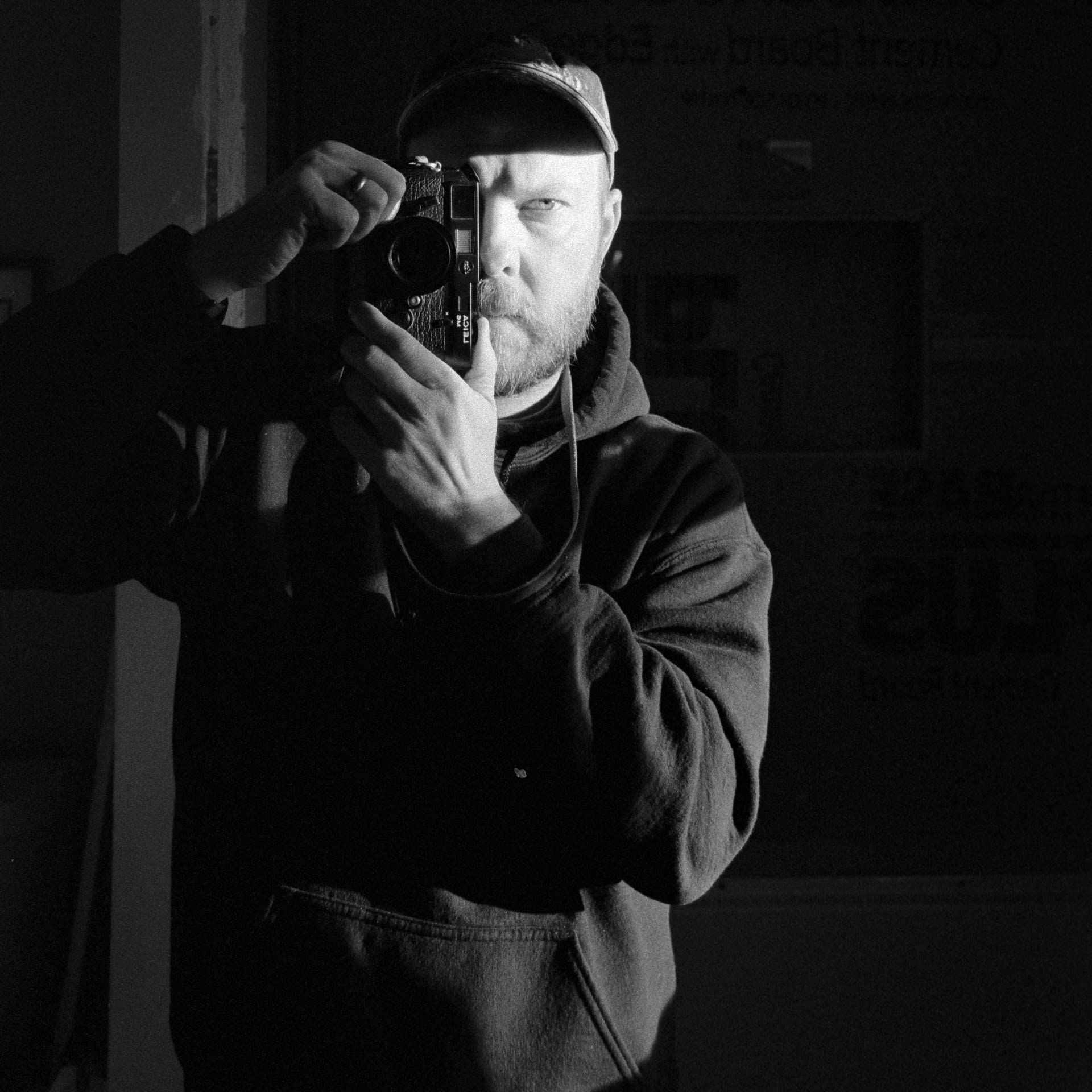self portrait with leica m6 in mirror