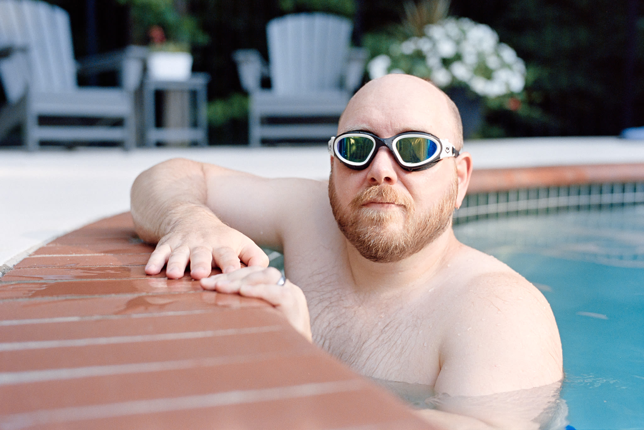 man in pool with goggles