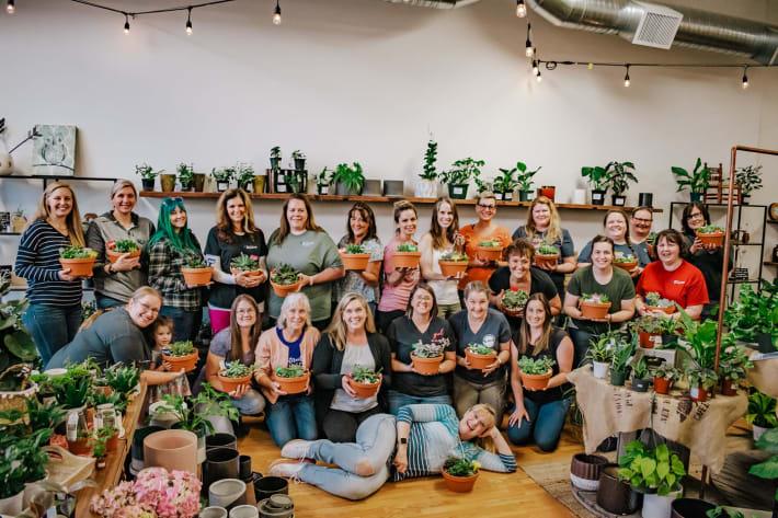 Sky Lakes nurses at Packer Plant company holding plants