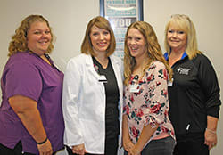 Photo of providers and team members at the King's Daughters' Health Convenient Care Center in Madison.