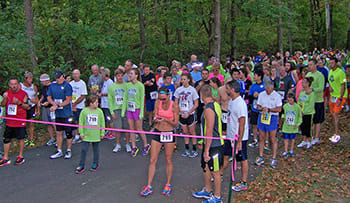 Runners and walkers line up for the start of RUN the FALLS 5K at Clifty Falls State Park in Madison