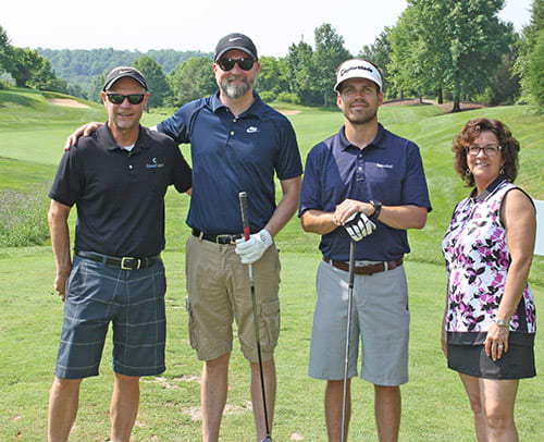 Photo of one team at the Golf Benefit