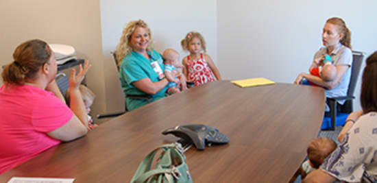 Annie Havner, center, Lake Regional's lactation consultant, encourages breast-feeding moms to find support from their peers.