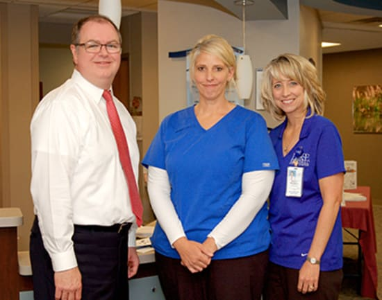 2)	Angel Frisbie, R.N., winner of the Beacon of Patient-Centered Care, with Kevin McRoberts, senior vice president of operations, and Marcy Maxwell, Lake Regional Cancer Center director.