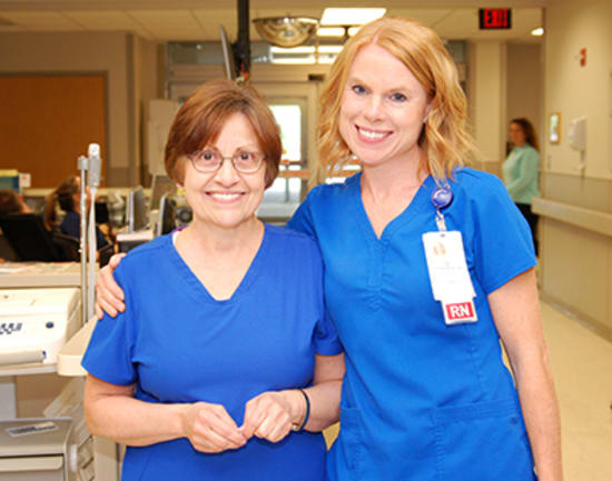 4)	Lana Singer, R.N., winner of the Beacon of Service Excellence, with Amy Funderburk, Emergency Department nurse manager.