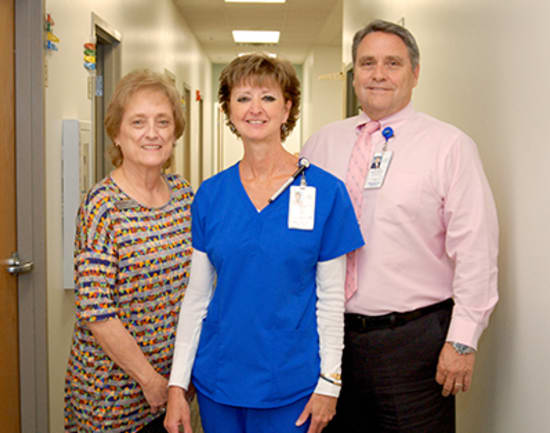 5)	Patti Swanson, MLT, winner of the Beacon of Commitment to Community, with Judy Zickefoose, manager of Lake Regional Clinic – Camdenton, and Michael Burcham, vice president of Physician Practices.