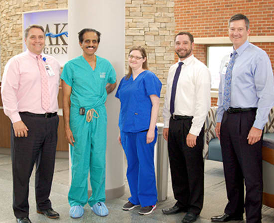 Michael Burcham, vice president of Physician Practices; Cardiologist Muthu Krishnan, M.D., FACC; Travis Messer, director of Specialty Group - Medical Division; and Dane W. Henry, CEO, present Sara Clemmons, LPN, with the Licensed Practical Nurse of the Year award.