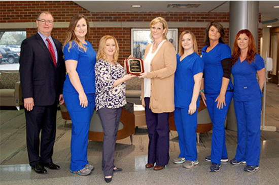 Lake Regional Wound Healing Center receives its Center of Distinction award. Pictured are Lake Regional Health System Senior Vice President of Operations Kevin McRoberts; Wound Healing Center Nurse Manager Lisa Caudle; Wound Healing Center Director Laurie Lowther; Healogics representative Carrie Clark; and Wound Healing Center staff Rhonda Weaver, Sharon Jones and Traci Barrett.