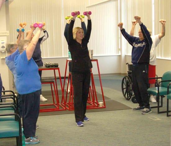 Jody Corpe, an exercise physiologist at Lake Regional Cardiopulmonary Rehabilitation, leads an exercise class for pulmonary rehab patients.