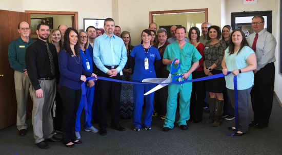 Brian Swanson, P.A. (front row, third from left), and Orthopedic Surgeon Jeff Jones, D.O. (front row with scissors), celebrate the opening of Lake Regional Orthopedics - Camdenton with members of the Camdenton Area Chamber of Commerce and representatives of Lake Regional Health System.