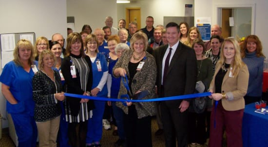 Jill Wilke, director of Lake Regional Palliative Care, Home Health & Hospice, and Dane W. Henry, Lake Regional Health System CEO, cut the ribbon to commemorate the opening of Lake Regional Hospice. Several Lake Regional administrators and staff also were present, as well as representatives from the Lake Area Chamber of Commerce, Camdenton Area Chamber of Commerce and Lake West Chamber of Commerce.