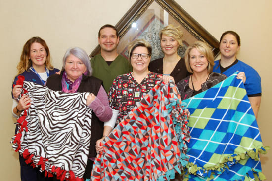 Lake Regional Health System Diagnostic Imaging staff pose with handmade blankets for Lake Regional Cancer Center patients. Pictured are, left to right, Kristy Wood, RT(R)(M); Carol Meyer; Kevin Wyrick, RT(R)(CT)CNMT; Jetty Meyer, RT(R)(M); Mandy Bargfrede, RT(R)(M); Denise Keppler, BSRT(R)(M)(BD); and Chastity Rapier, R.N.