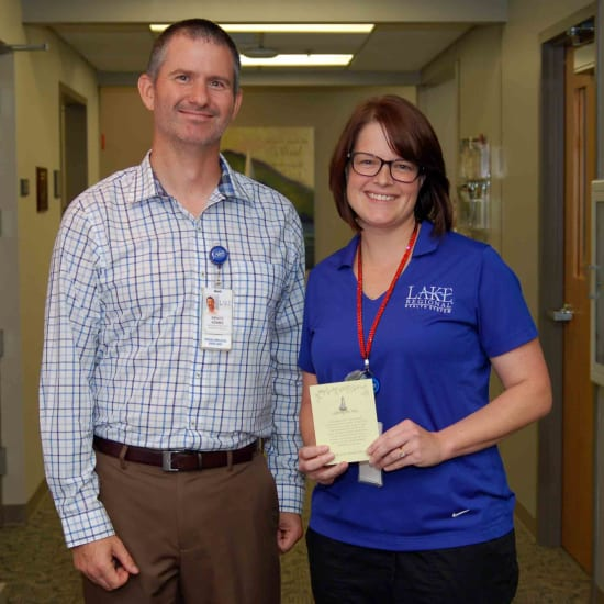 Bruce Adams, HR assistant director, and Stacy Anstine, RT(R)(T), CMD, winner of the Beacon of Patient-Centered Care
