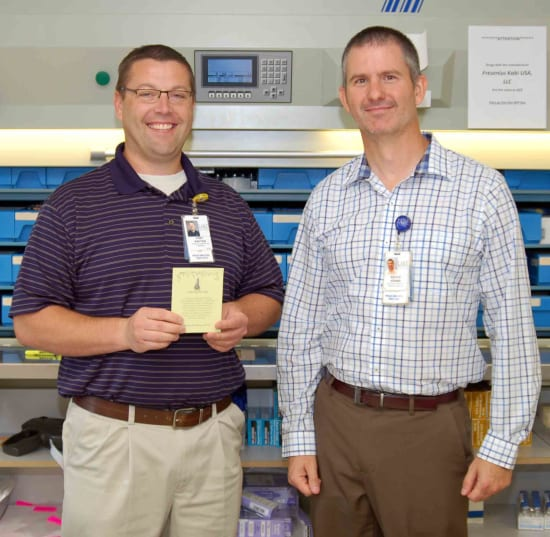 Tony Kauten, PharmD, winner of the Beacon of Clinical Excellence, and Bruce Adams, HR assistant director