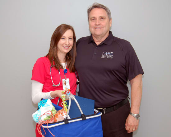 René Revelle, FNP-C, Lake Regional Express Care, received the Advanced Practice Nurse of the Year award. This award recognizes a nurse practitioner who is a role model for integrity, clinical excellence and a positive attitude. Revelle lives in Eldon. She is pictured with Michael Burcham, vice president of Physician Practices.