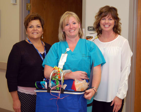 """Angela Preble, R.N., Family Birth Center, received the Spirit of Nursing award. Florence Nightingale said, """"Nursing is an art,"""" and one must have passion to create masterpieces. This award recognizes a nurse who always looks for opportunities to brighten the day of patients and co-workers. Preble lives in Linn Creek. She is pictured with Patti Muxlow, senior vice president of Clinical Services, and Melissa Hunter, director of Nursing."""